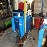 Un montage de chaudière de gas-oil Buderus dans une salle de chaudières
